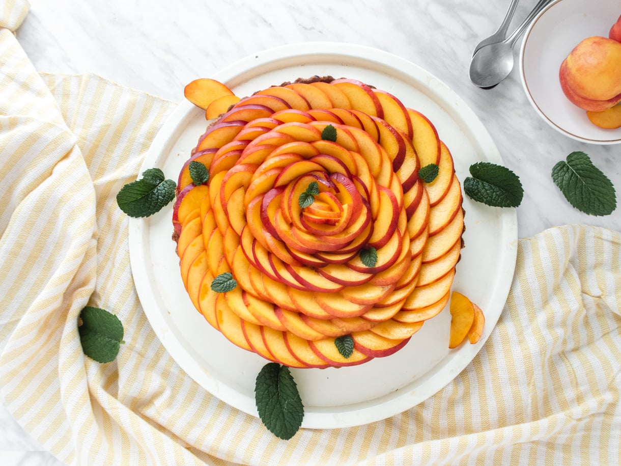 top down view of the vegan tart garnished with nectarines garnished as a rose