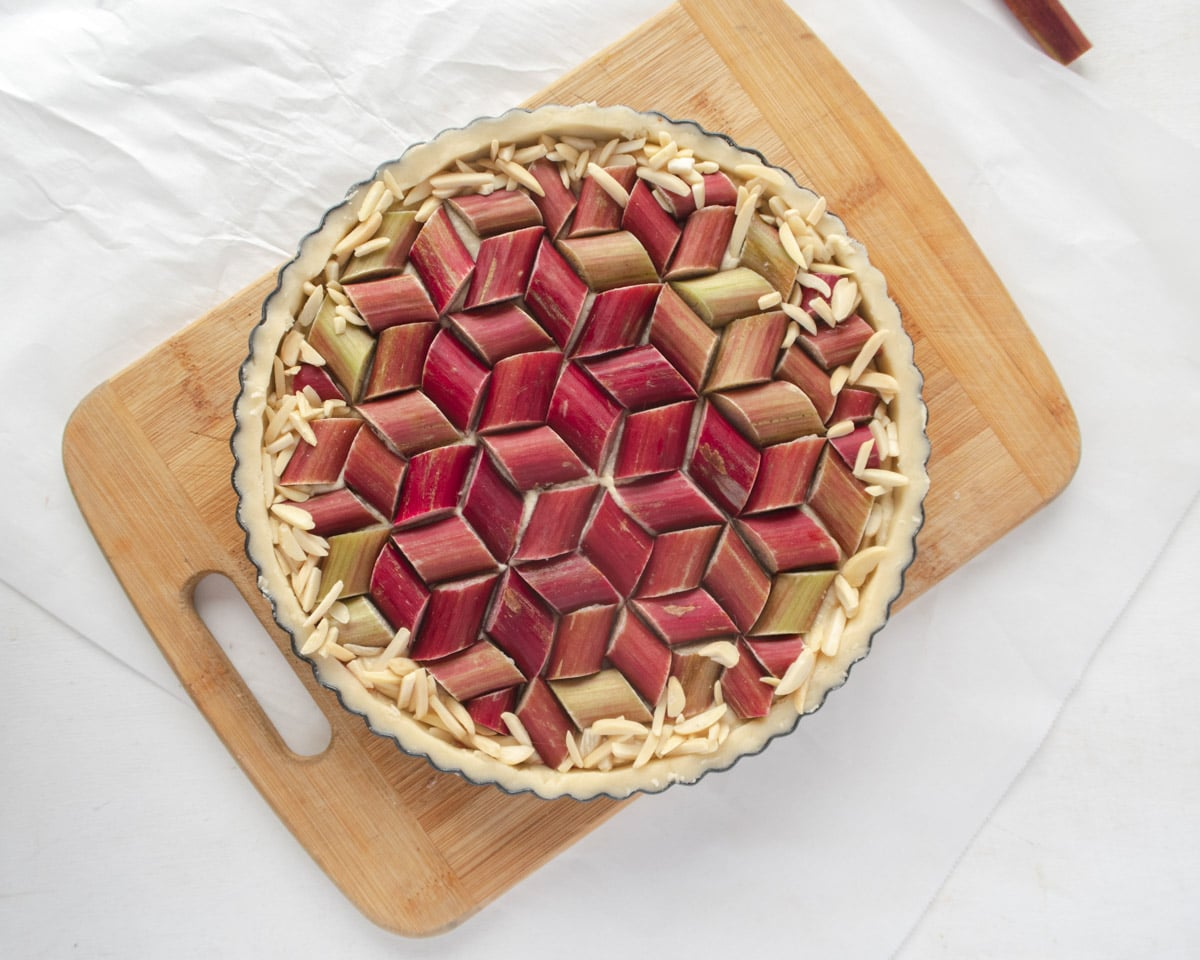 top down view the rhubarb geometric pattern on a frangipane filled tart