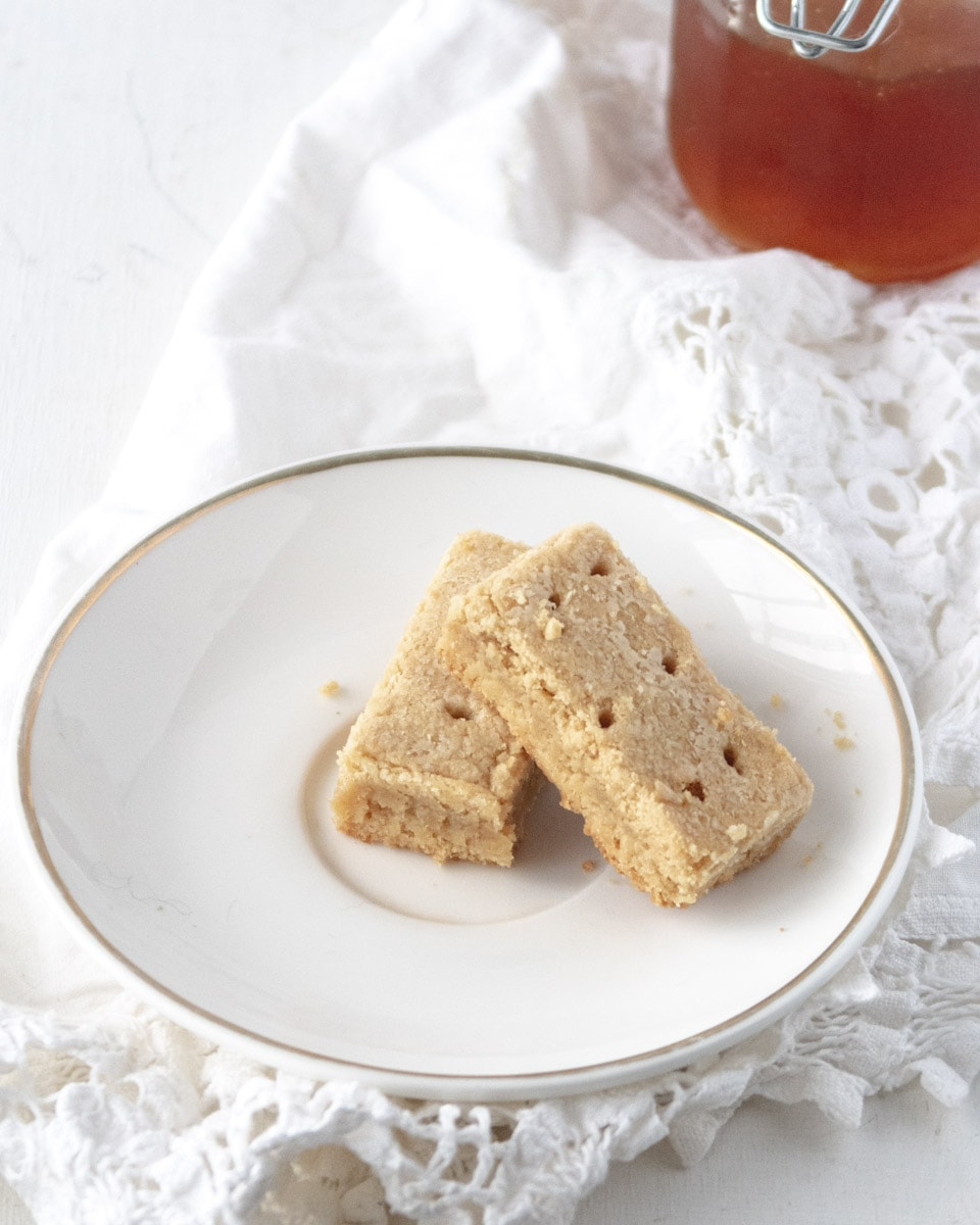 2 gluten-free shortbread cookies on a small white plate