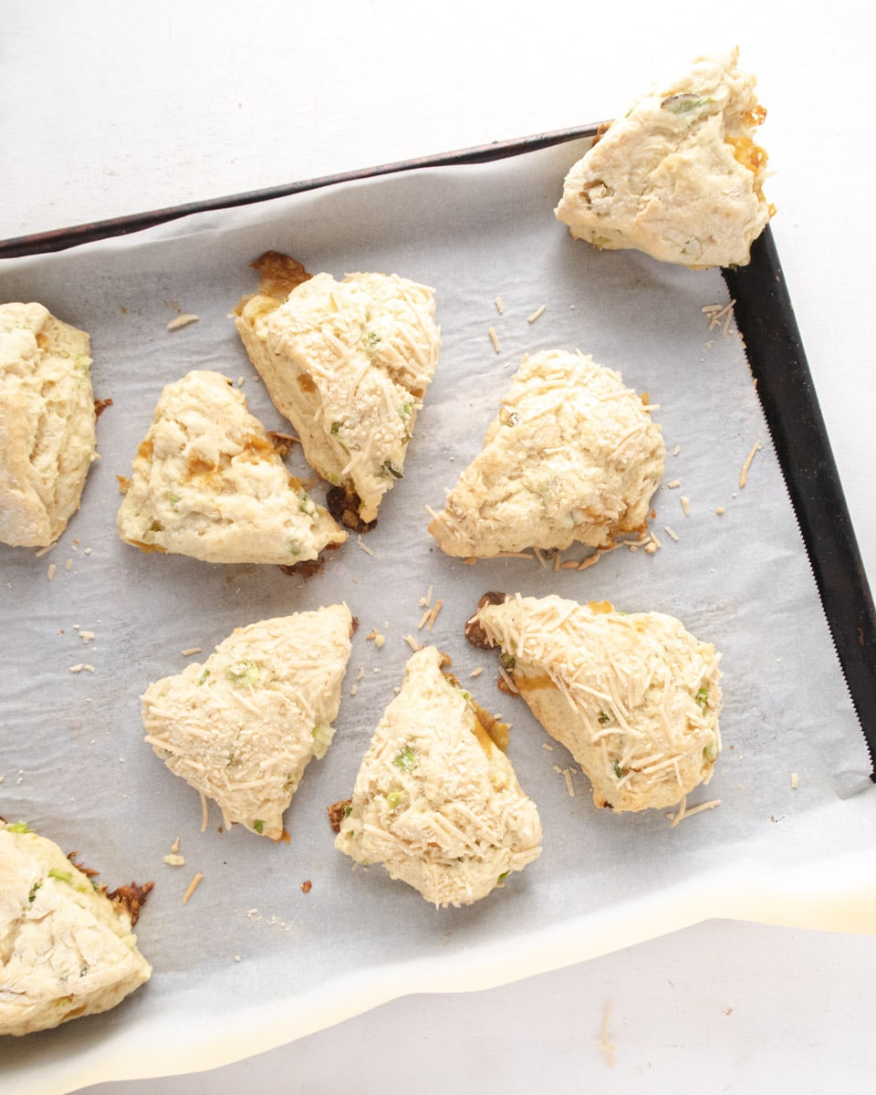 scones placed in a circle on a parchment paper lined baking tray