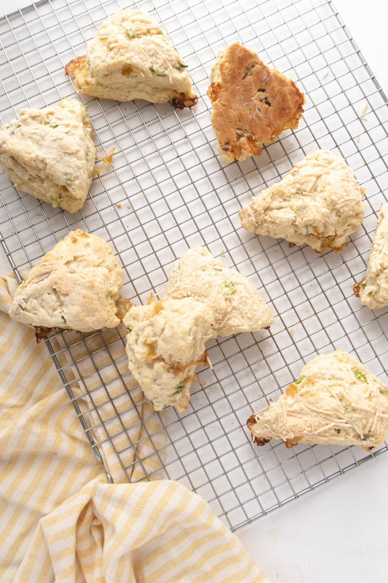 9 vegan scones placed randomly on a on a wirer cooling rack