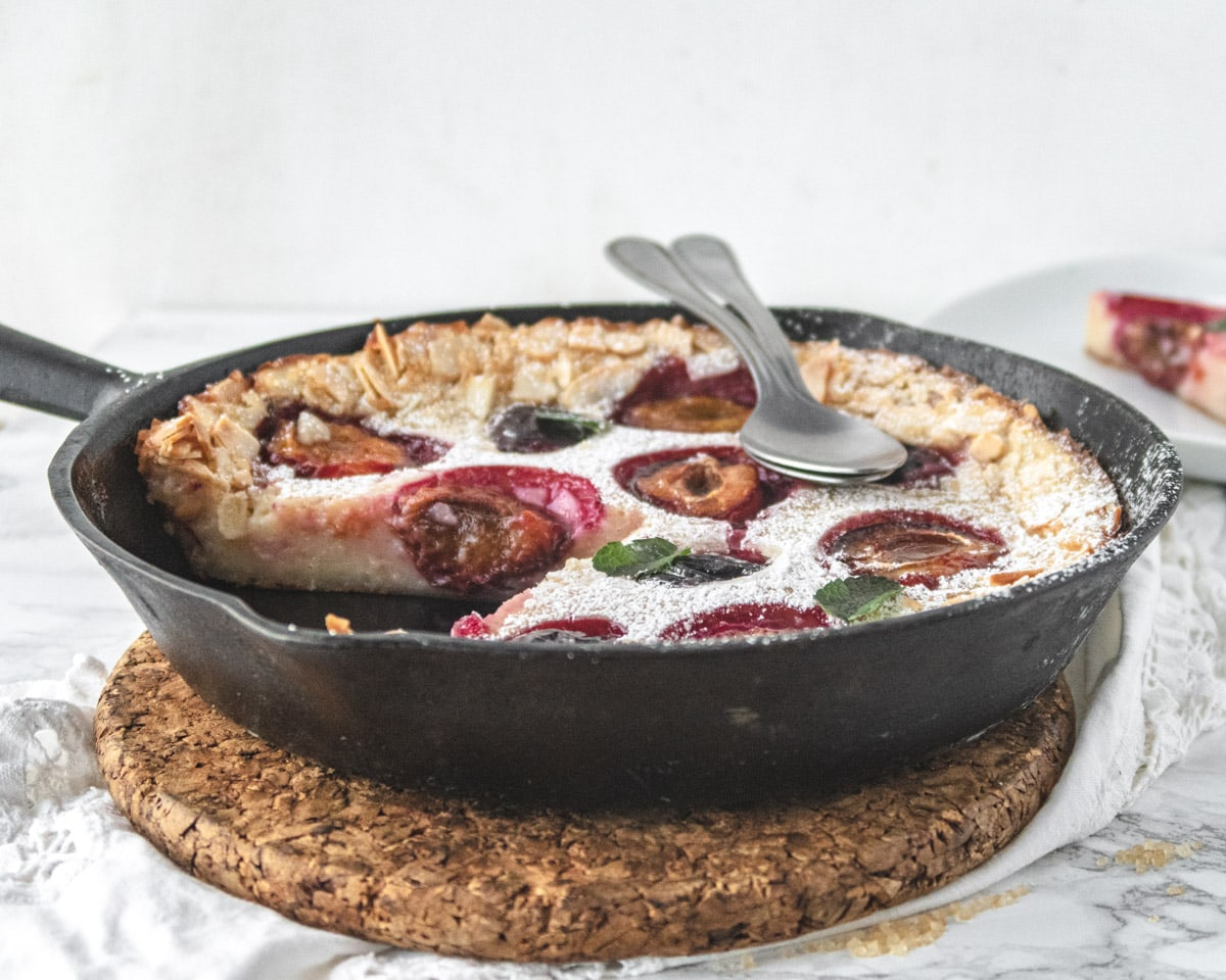 Side view of a clafoutis with a slice cut out