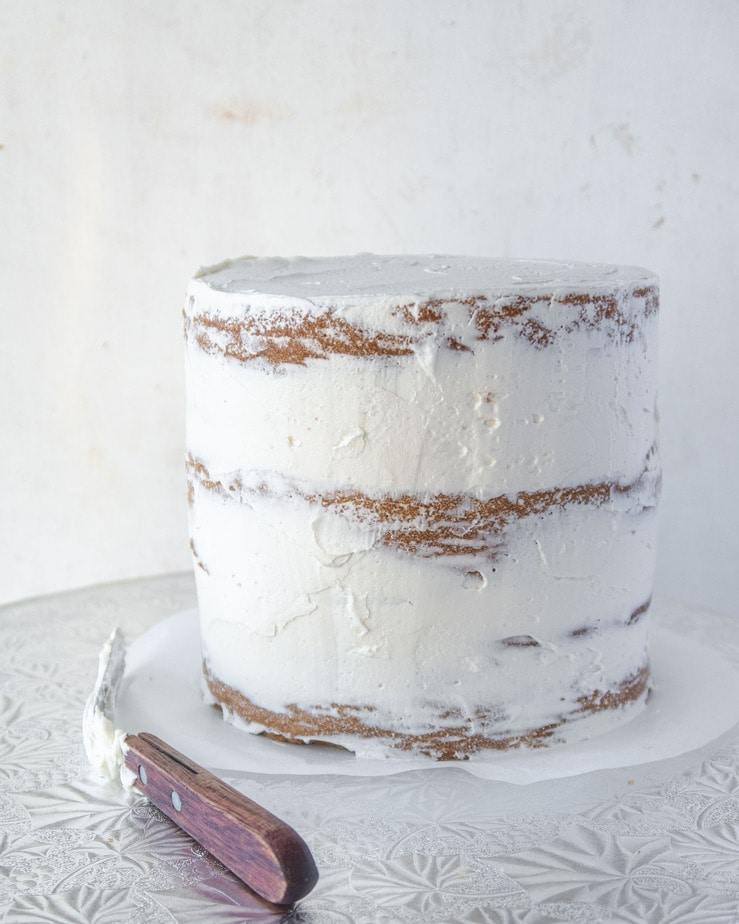 cake crumb-coated with dairy-free meringue buttercream