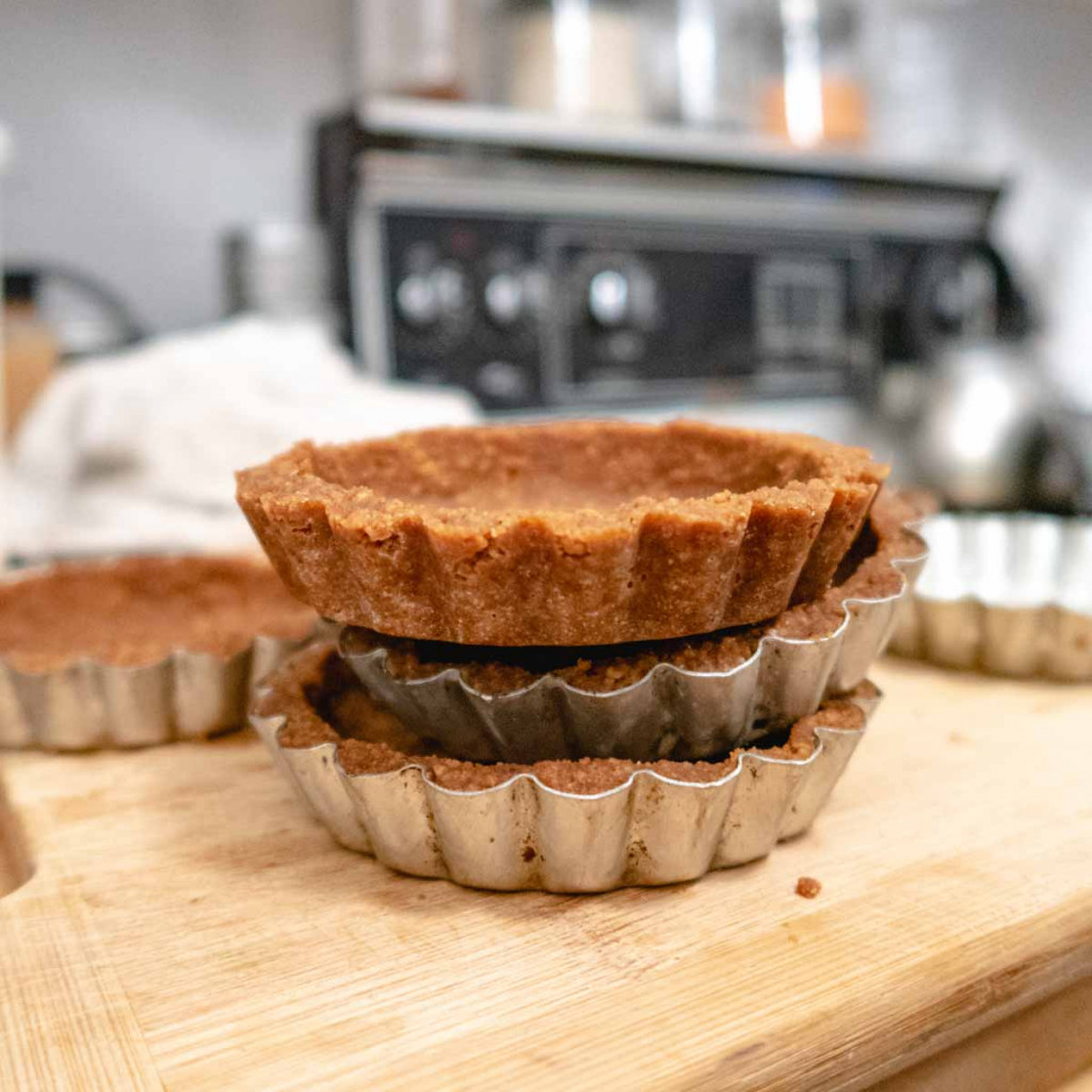 3 vegan Biscoff COokie crusts stacked on top of each other